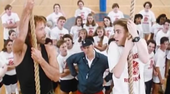 Chuck Norris and Jonathan Brandis climb rope in Sidekicks